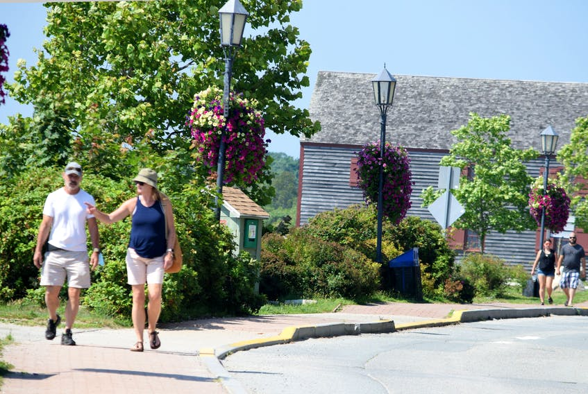 People enjoy the sights as they stroll along historic Dock Street in Shelburne. KATHY JOHNSON • TRICOUNTY VANGUARD