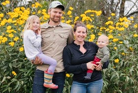 Amy and David Hill with their kids, Ayla and Zeke. The Hills own and operate Snowy River Farms in Cooks Brook, N.S. They have pasture-raised chickens, pasture and woods-raised pork, as well as market garden vegetables.
