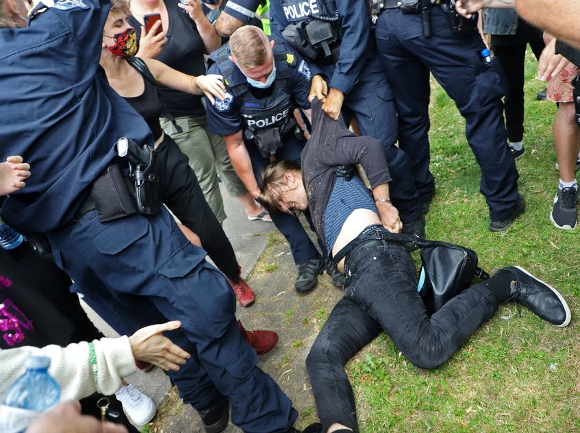 A protester is dragged away by police as a protest against the removal of temporary housing shelters turned into a major confrontation Wednesday, Aug. 18, 2021. - Tim Krochak