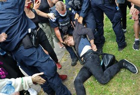 A protester is dragged away by police, a shelter removal turned into a major confrontation with Halifax regional police in Halifax Wednesday August 18, 2021.  TIM KROCHAK PHOTO