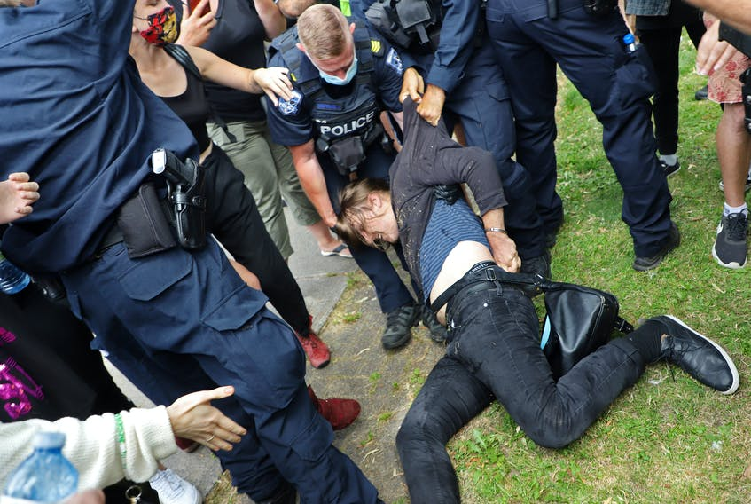 A protester is dragged away by police, a shelter removal turned into a major confrontation with Halifax regional police in Halifax Wednesday August 18, 2021.TIM KROCHAK PHOTO