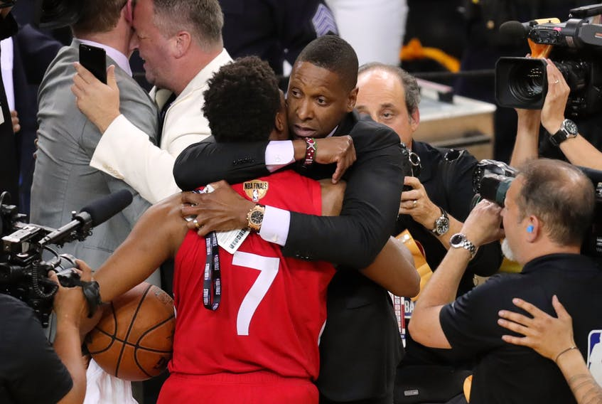 Raptors president Masai Ujiri (right) hugs guard Kyle Lowry after capturing the the 2019 NBA championship at Oracle Arena.