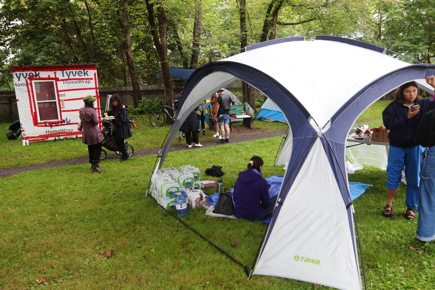 About 20 supporters waited at the micro park at the corner of Chebucto Road and Dublin Street in Halifax on Thursday, Aug. 19, 2021. The shelter and tents weren't occupied but the supporters said they were there in case the city decides to forcibly remove the housing structures. - Eric Wynne