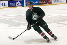 Defenceman Dylan MacKinnon tracks the puck during the first day of Halifax Mooseheads training camp at the RBC Centre in Dartmouth on Thursday. - Willy Palov