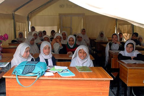 Afghan schoolgirls sit in a tent as they attend class in Kandahar, Afghanistan in 2014. Postmedia file photo
