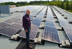 Kings County Mayor Peter Muttart on the roof of the municipal complex in Coldbrook, where solar panels have been installed to help offset the building's reliance on fossil fuels. ASHLEY THOMPSON • Special to the SaltWire Network