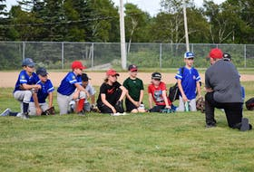 Members of the Sydney Sooners under-11 'AA' team are shown listening to coach George Long, right, during a practice at Vince Muise Memorial Field in Sydney River on Wednesday. The team will compete in the Nova Scotia provincial championship tournament this weekend in Bridgewater. JEREMY FRASER/CAPE BRETON POST.