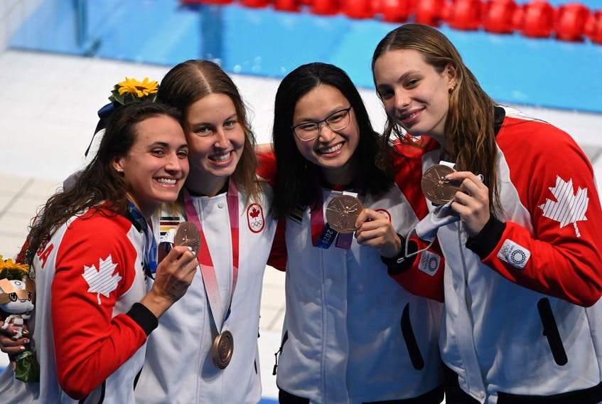 Bronze medallists (from L) Canada's Kylie Masse, Canada's Sydney Pickrem, Canada's Margaret MacNeil and Canada's Penny Oleksiak pose with their medals after the final of the women's 4x100m medley relay swimming event during the Tokyo 2020 Olympic Games at the Tokyo Aquatics Centre in Tokyo on August 1, 2021. (Photo by Jonathan NACKSTRAND / AFP) (Photo by JONATHAN NACKSTRAND/AFP via Getty Images)