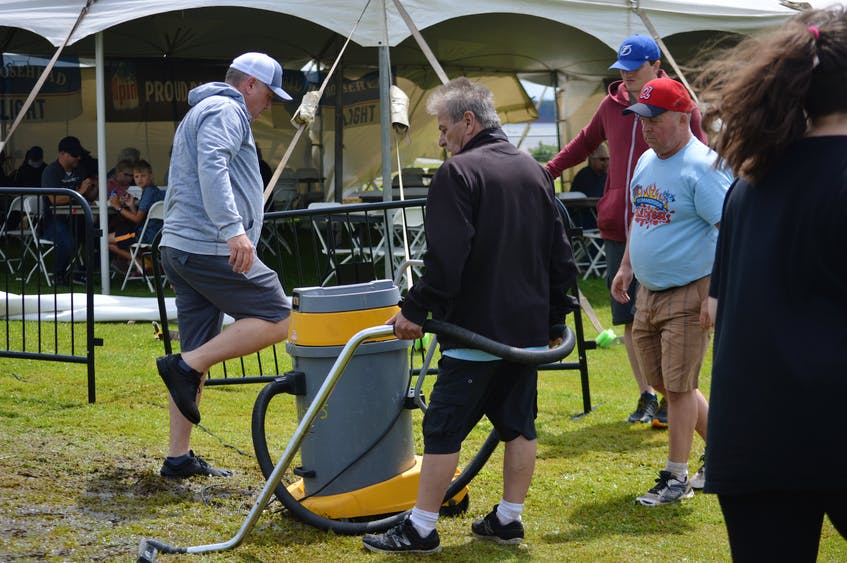 Festival workers tried to dry up grounds on Saturday after Atlanticade's official opening was delayed Friday due to heavy rains. - Kyle Reid