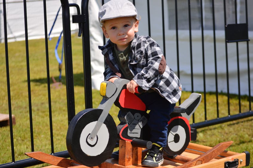 Fifteen-month-old Lorenzo Caissie may not have had the fastest motorcycle at Atlanticade last weekend, but it may have been one of the most stylish. - Kyle Reid