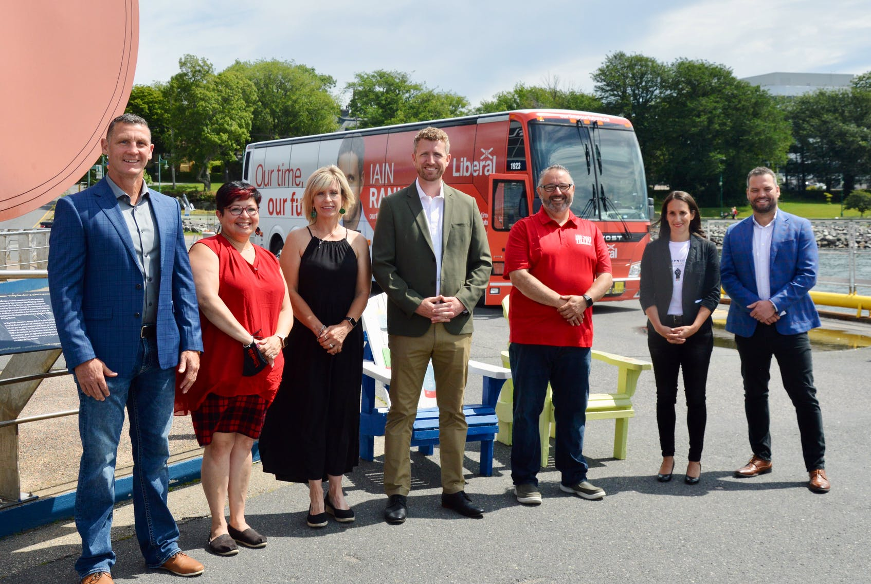 The Nova Scotia Liberal Party campaign train made a Sunday morning stop on the Sydney waterfront where Premier Iain Rankin, who arrived in a specially wrapped, election-themed tour coach, was joined by six of his party's Cape Breton candidates for the unveiling of his new skills and training platform that features a $78-million investment in the Nova Scotia Community College. From left: John John McCarthy (Glace Bay- Dominion), Nadine Bernard (Victoria-The Lakes), Heather Peters (Cape Breton East), Rankin, Fred Tilley (Northside-Westmount), Michelle Wilson (Cape Breton Centre-Whitney Pier) and Education Minister Derek Mombourquette (Sydney-Membertou). DAVID JALA/CAPE BRETON POST