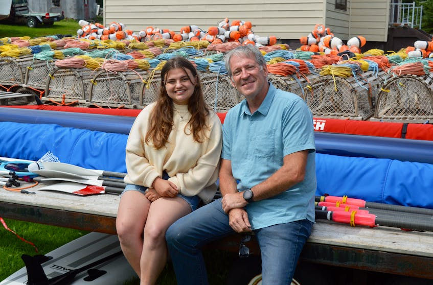 Hannah Forgeron and her Olympic gold medal-winning father Michael have been following the Tokyo Games during their visit to the family's home in the tiny Cape Breton fishing village of Main-a-Dieu. DAVID JALA/CAPE BRETON POST