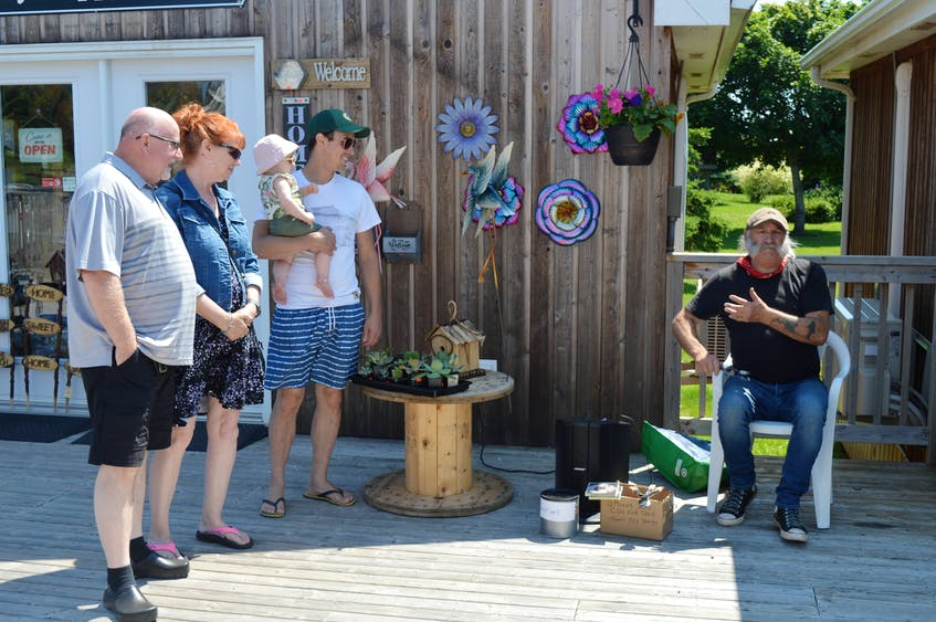 Brendon Peters entertains tourists outside the shops at Seawalk Park in North Rustico on July 29. - Dave Stewart