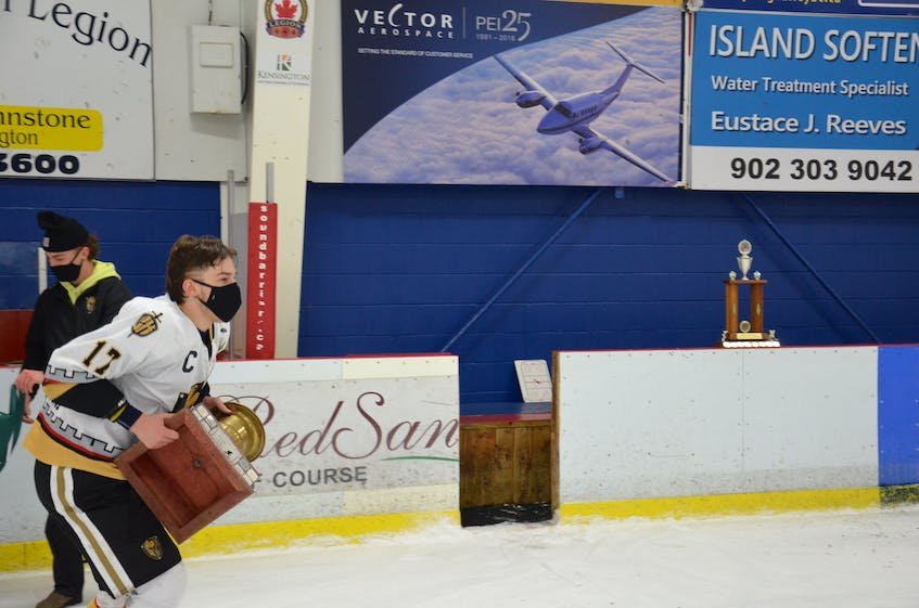 Captain Max Chisholm hoists the championship trophy after the Charlottetown Bulk Carriers Knights swept the Kensington Monaghan Farms Wild in the best-of-seven 2021 provincial major under-18 hockey championship on March 27. - Jason Simmonds