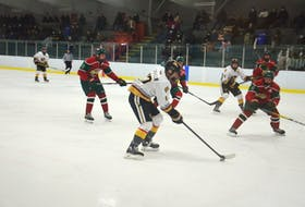 Charlottetown Bulk Carriers Knights right-winger Max Chisholm controls the puck during a major under-18 hockey game against the Kensington Monaghan Farms Wild at Credit Union Centre in Kensington.