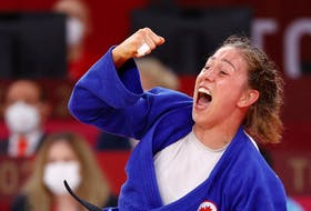 Catherine Beauchemin-Pinard of Canada celebrates after winning bronze against Anriquelis Barrios of Venezuela