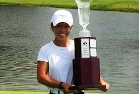 Jasmine Ly poses with the trophy after winning the Ontario Women's Amateur tournament.