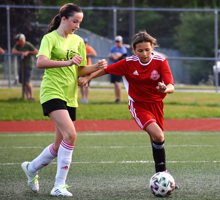 Lydia Graves of Riverview, right, carries the ball as she's watched by Taylor Stubbert of New Waterford during Cape Breton and District Soccer League under-13 girls' quarterfinal action at Cape Breton Health Recreation Complex on Friday. Riverview won the game 4-0. JEREMY FRASER/CAPE BRETON POST. - Jeremy  Fraser