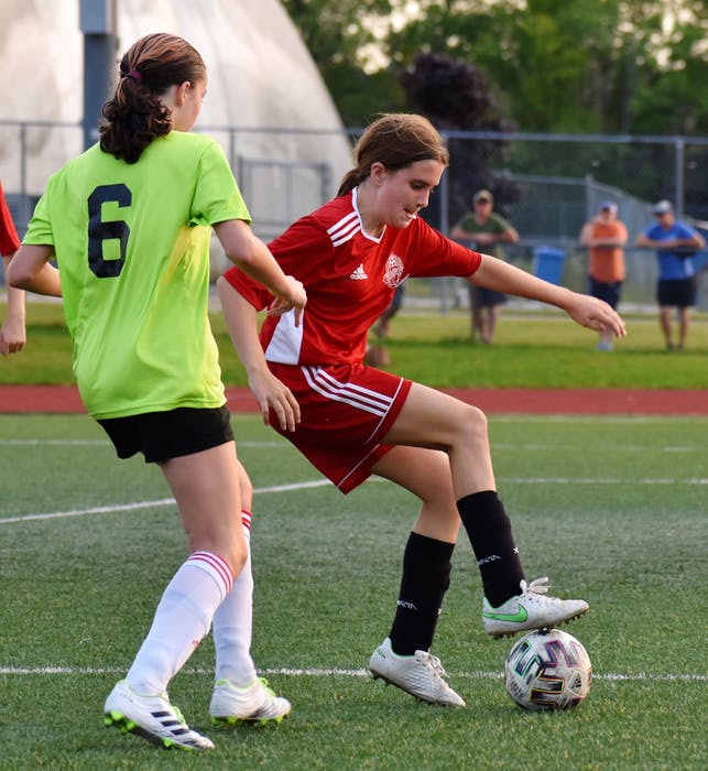 Cate MacAulay of Riverview, right, protects the ball as she's challenged by Taylor Stubbert of New Waterford during Cape Breton and District Soccer League under-13 girls' quarterfinal action at Cape Breton Health Recreation Complex on Friday. Riverview won the game 4-0. JEREMY FRASER/CAPE BRETON POST. - Jeremy  Fraser
