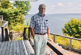 Retired engineer and businessman Brian Shebib, shown above at his home overlooking Sydney harbour, is being inducted into the Cape Breton Business and Philanthropy Hall of Fame on Aug. 31. The North Sydney native spent almost his entire five-decade long career in the commercial fishing industry. DAVID JALA/CAPE BRETON POST