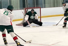 Goalie Mathis Rousseau positions himself to make a stop against Jake Freelove at Halifax Mooseheads training camp at the RBC Centre in Dartmouth on Friday. - Willy Palov