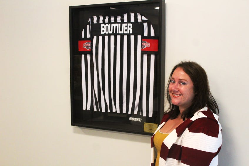 TALO on Ice manager Rita Murphy shows off the framed referee jersey of the late Henry Boutilier, a longtime Glace Bay sports coach and community booster. DAVID JALA/CAPE BRETON POST - David Jala