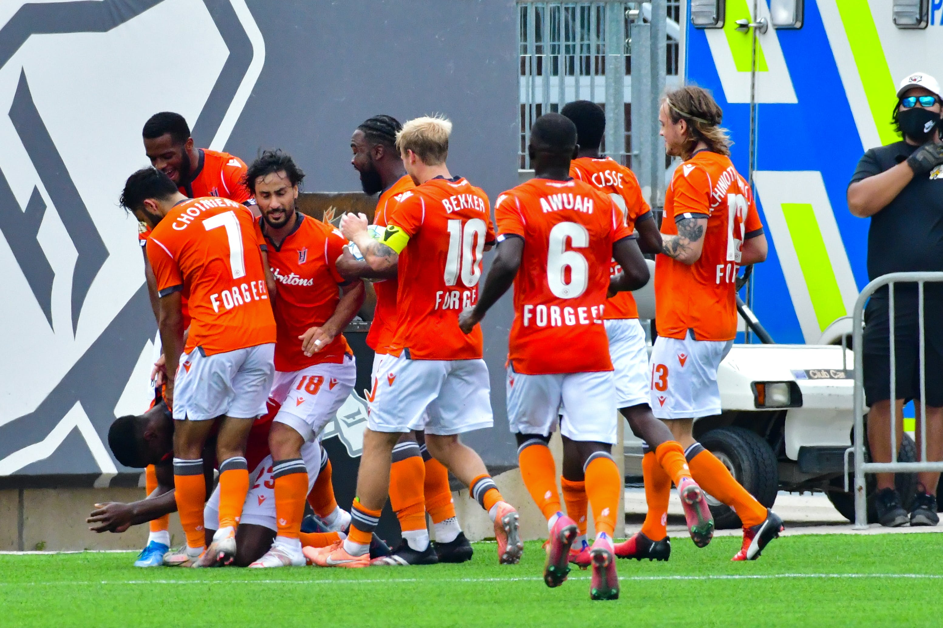 Forge FC celebrate Kwame Awuah's goal in the 96th minute in a 1-1 draw with HFX Wanderers on Sunday afternoon in Hamilton, Ont. - Forge FC Hamilton / Ryan McCullough