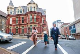 Premier-designate Tim Houston is accompanied by Nicole LaFosse, PC chief of staff, and communcations officer Catherine Klimek en route to visit the lieutenant-governor Thursday. -- Communications Nova Scotia