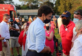 Justin Trudeau mingles with supporters at a campaign stop for Heath MacDonald's Malpeque campaign in the 2021 federal election. MacDonald can be seen on the left.