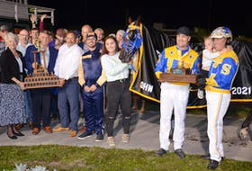 Smooth Lou won the 62nd edition of The Guardian Gold Cup and Saucer at Red Shores Racetrack and Casino at the Charlottetown Driving Park in the early minutes of Aug. 22. From left: P.E.I. Lt.-Gov. Antoinette Perry; Brad Works, regional managing editor of title sponsor The Guardian; P.E.I. Premier Dennis King, and Ian Scott, executive vice-president and chief operations officer at the SaltWire Network, publisher of The Guardian, get ready to present the Gold Cup and Saucer Trophy. Also taking part are winning Gold Cup and Saucer Ambassador Jack MacKenzie, groom Megan Lewis, winning trainer Patrick Shepherd and winning driver Robert Shepherd and his daughter Taylor.