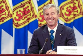 Premier-designate Tim Houston is all smiles as he delivers the province's back-to-school plan, along with Dr. Robert Strang, on Monday.