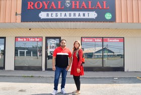 Waqar Ahmed, left, and wife Fazeela stand in front of the Royal Halal restaurant they plan to open in September. The eatery is located in the Welton Street Plaza in Sydney. DAVID JALA/CAPE BRETON POST