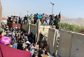 A still image taken from video shows crowds of people near the airport in Kabul, on Aug. 23. ASVAKA NEWS via REUTERS