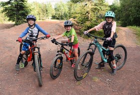 """Max Simms, 7, Janelle Cumming, 5 and Peaka Simms, 9, have biked """"since they were in diapers."""" They love hitting the hills and trying new skills."""