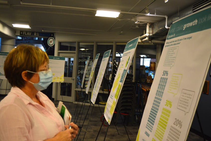 Lisa McNeil-Campbell, chairperson of the Hawks Dream Field Society in Dominion, takes in a CBRM Forward open house Monday night at the Joan Harriss Cruise Pavilion. — IAN NATHANSON/CAPE BRETON POST