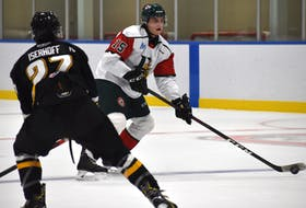 Alexandre Tessier of the Halifax Mooseheads, right, looks towards the net as he's watched by Wynston Isheroff of the Cape Breton Eagles during Quebec Major Junior hockey League preseason action at Miners Forum in Glace Bay on Wednesday. Cape Breton won the game 2-1.