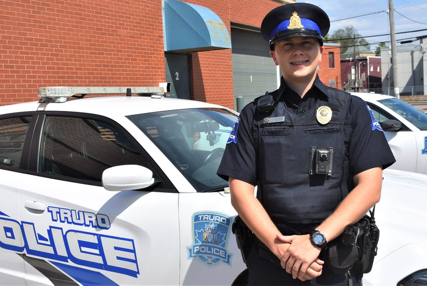 Cst. Michael Young of the Truro Police Service standing just outside the department. Clearly visible on the left-side of his uniform is the body camera which is now being deployed full-time by Truro police, following a four-month pilot project.