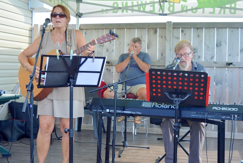 Janet Bickerton, from left, Mark MacQueen and Ralph Dillon perform at the Portside Beer Garden on the Sydney waterfront Wednesday afternoon as part of the ninth annual Cape Breton Jazz Festival. The festival, which features jazz musicians performing at both indoor ticketed settings and free outdoor shows throughout the area, continues until Saturday. Due to unforeseen circumstances, two Friday evening shows — the Battle of the Tenor Saxophones and the Late Night Jam Sessions, have been cancelled. For information on scheduled performers, event locations and showtimes, visit capebretonjazzfestival.com. Chris Connors/Cape Breton Post