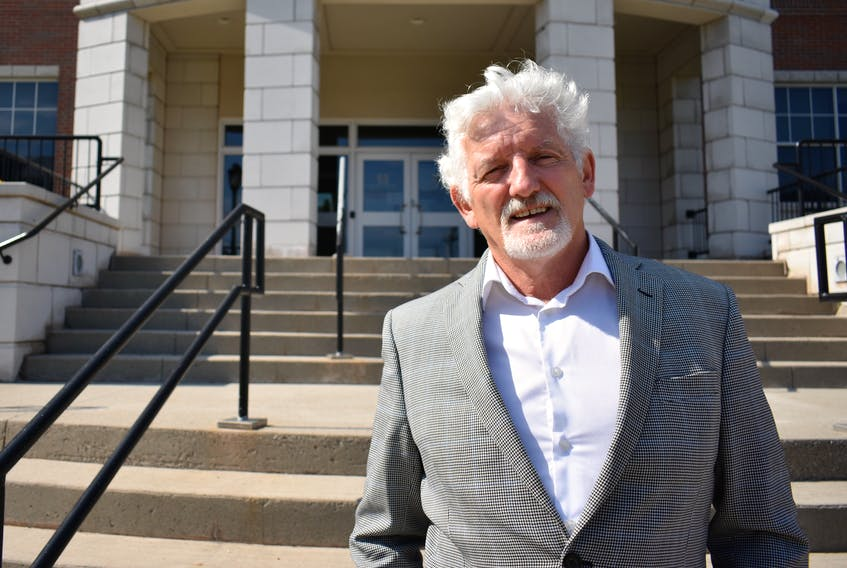 Holland College president Sandy MacDonald stands outside a building on the Charlottetown campus on Aug. 25. Earlier in the day, the college announced it would be mandating all students and staff to be fully vaccinated by Oct. 15.