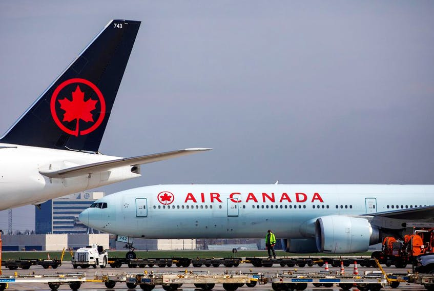 Air Canada planes parked at Toronto Pearson Airport in Mississauga, Ont., on April 28, 2021.