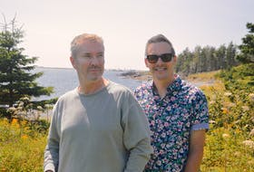 Internationally celebrated interior designers Justin Ryan, left, and Colin McAllister stand on the grounds of the Point of View Suites in Louisbourg. The couple plans to remodel the scenic seaside retreat and relaunch it as North Star. Chris Connors/Cape Breton Post