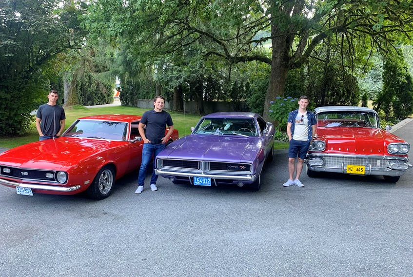 High school car buddies from Coquitlam, B.C., from left to right, Mateo Cecchinia, Marc Testa and Matthew Marsolais help each other restore their collector cars, respectively, a 1968 Chevrolet Camaro, a 1969 Dodge Charger, and a 1958 Pontiac Laurentian. Alyn Edwards/Postmedia News
