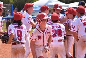 The Truro U13 AAA Bearcats meet Austin Brown at the plate following his dramatic sixth-inning home run in the semi-final game versus the Halifax Mets Sunday morning.