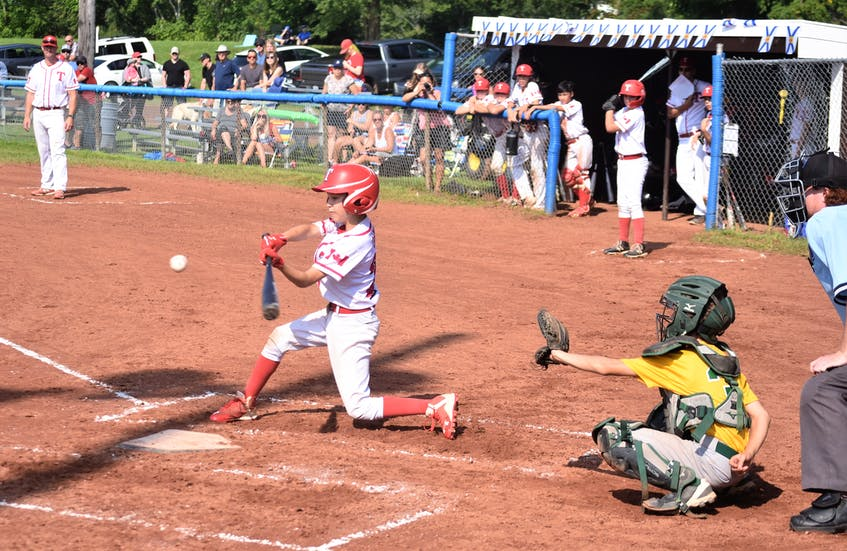 Truro's Jordan Carr drives this ball to the right side versus the A's. - Richard MacKenzie