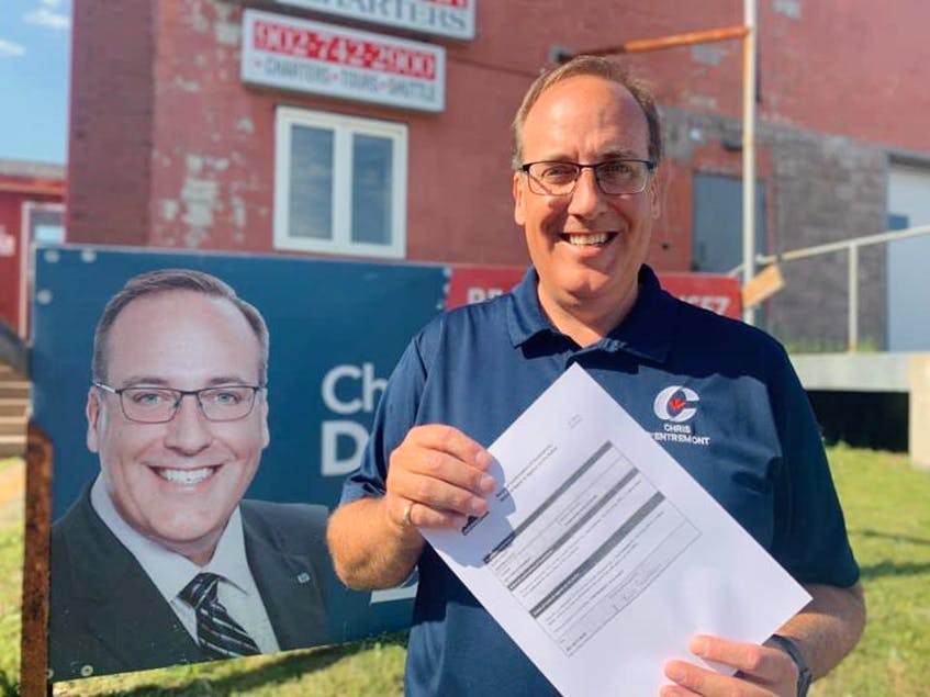Chris d'Entremont, the Conservative candidate for West Nova in the Sept. 20 federal election, poses with his candidate registration form in front of one of his campaign signs. - Contributed
