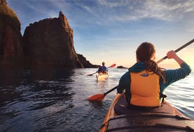 NovaShores Adventures offers daily sea kayak tours that explore the area's geology and natural history, including the famous Three Sisters sea stacks. - Photo Courtesy Tourism Nova Scotia / Scott Munn.