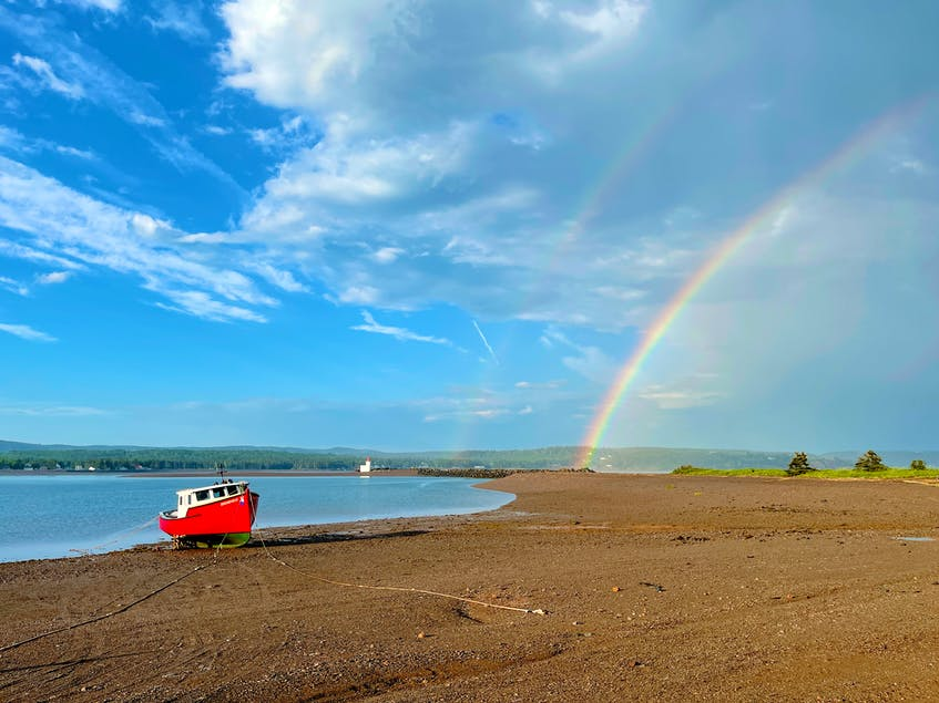 There's so much beauty to explore on local beaches, like this rainbow captured at Second Beach. - Photo Courtesy Sandy Graham.