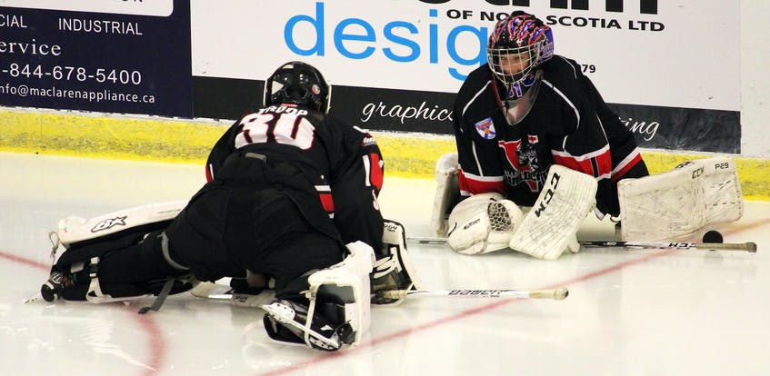 Goalies Grady LeCouter, left, and Jake Spidle stretch prior to the contest. - Jason Malloy