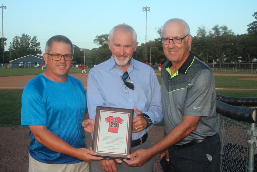 Ian Mosher, centre, was presented a plaque after he was inducted into the Kentville Wildcats Hall of Fame Aug. 17 at Memorial Park. His former teammates took part in the ceremony, including Barney Van Blarcom, left, and Bill Young. The ceremony was held prior to the Wildcats hosting the Dartmouth Moosehead Dry in Nova Scotia Senior Baseball League action. The Wildcats won the game 6-5 on Colby Turple's two-out single in the bottom of the eighth inning. Kentville erased a five-run deficit to capture the victory and improved to 7-9 on the season. Caleb Medicraft picked up the win after throwing six scoreless innings of relief.