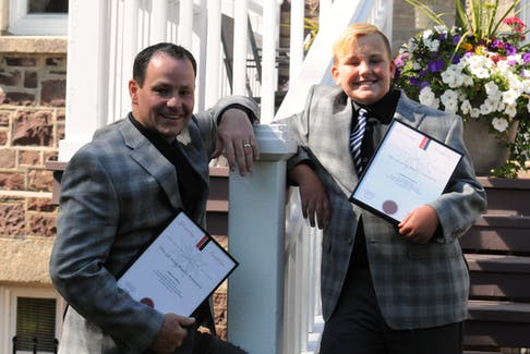 Mike Upshall and his 10-year-old Parker, both of Torbay, received life-saving awards at Government House. Joe Gibbons/The Telegram